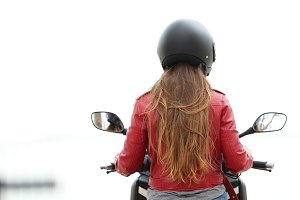 Back view of a motorbiker on a moto