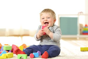 Baby laughing and playing with toys