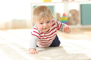 Baby crawling towards camera