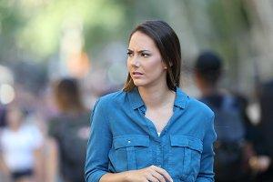 Anxious woman walking on the street