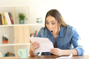 Amazed woman reading surprising news
