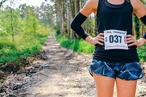 Unrecognizable female trail athlete