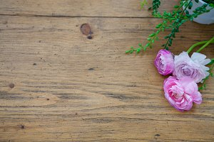 Ivy and Pink Flowers on Wood Table