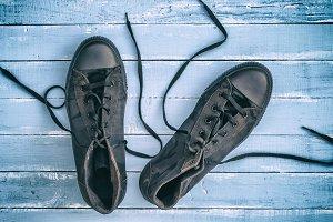 pair of black textile sneakers