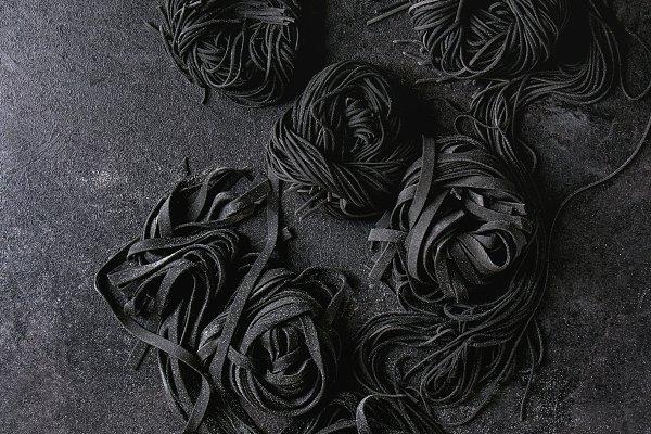 Fresh uncooked black pasta