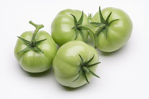 Green fresh tomatoes.