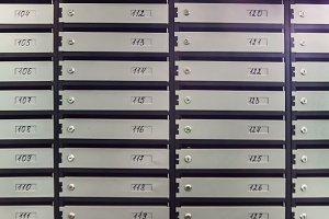Gray mailboxes in a block of flats,