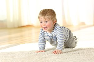 Cute baby crawling and laughing