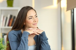 Confident pensive woman looking away