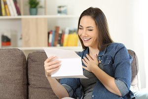 Candid woman reading hopeful news