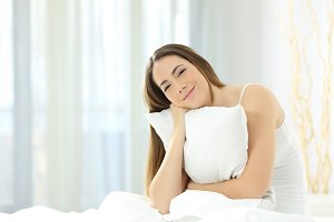 Candid girl holding a pillow