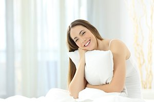 Candid girl embracing a pillow