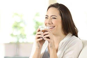 Candid girl drinking cocoa shake