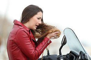 Biker woman complaining about hair