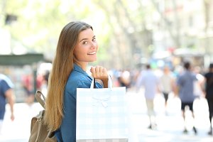 Beauty shopper showing shopping bags