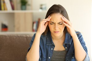 Woman complaining suffering migraine