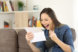 Excited woman reading great news