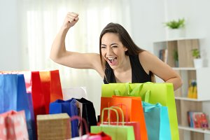 Excited woman looking at bags