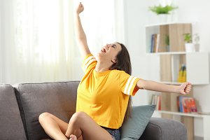 Excited teen stretching arms