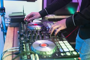 DJ plays and mix music on digital