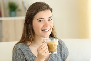 Happy teen holding a coffee milk