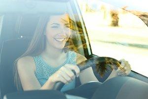 Happy driver driving a car