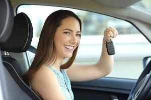 Happy car owner holding keys