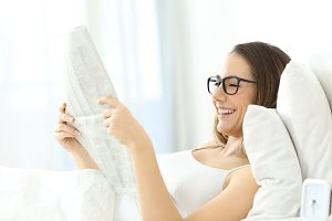 Girl wearing eyeglasses reading