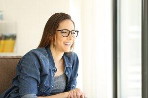 Girl wearing eyeglasses looking away
