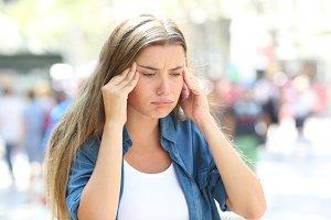 Girl suffering head ache