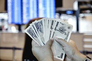 Woman Holding Money yen