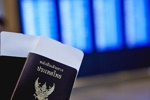 Left Hand Holding Thailand Passport