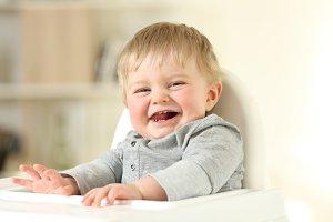 Joyful baby with his first teeth