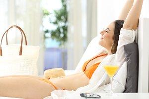 Happy woman relaxing in an hotel