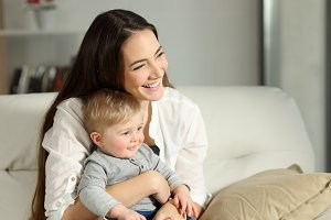 Happy woman and son looking away
