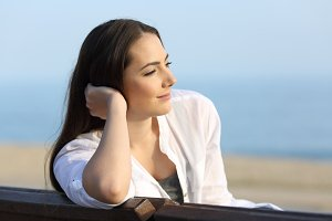 Pensive satisfied woman looking away