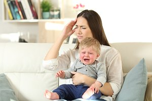 Mother suffering and baby crying