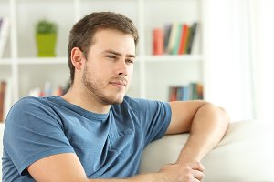 Man thinking looking away at home