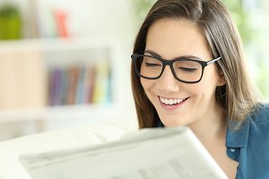 Lady wearing eyeglasses reading news