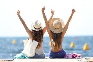 Joyful tourists on summer vacations