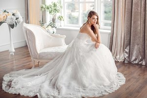 Bride in beautiful dress sitting