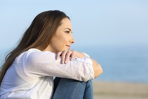 Relaxed woman thinking looking away