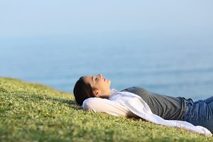 Relaxed woman resting on the grass