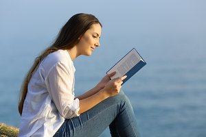 Relaxed woman reading a book