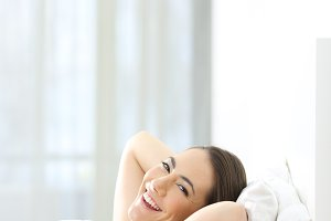 Relaxed woman looking at camera
