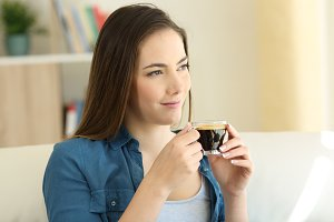 Relaxed woman drinking coffee