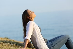 Relaxed woman breathing fresh air