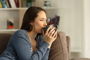 Relaxed happy woman drinking coffee