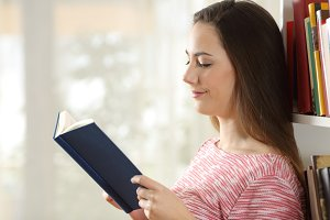 Profile of a woman reading a book