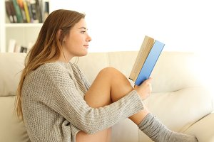 Profile of a teen reading a book